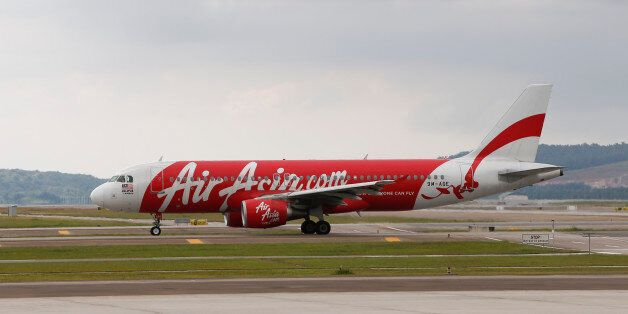 CORRECTS NUMBERS OF PASSENGERS ON BOARD - In this Nov. 26, 2014 photo, AirAsia Airbus A320-200 passenger...