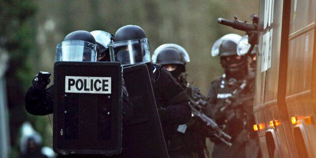 French police officers patrol in Longpont, north of Paris, France, Thursday, Jan. 8, 2015. Scattered...