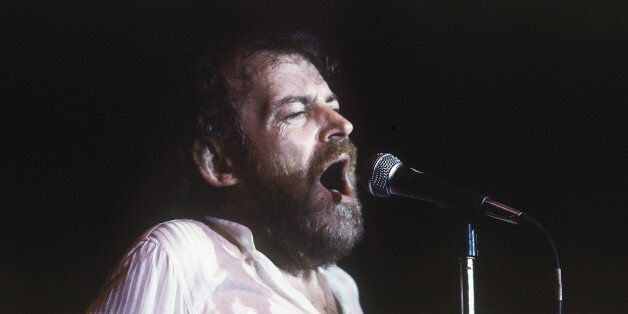 Pop singer Joe Cocker, signing during one of his performances in Tel Aviv, Israel in July 1983. (AP
