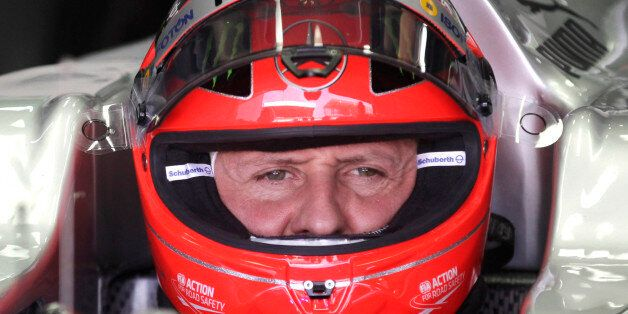FILE - In this Nov. 23, 2012 file photo, Grand Prix driver Michael Schumacher, of Germany, sits in his...