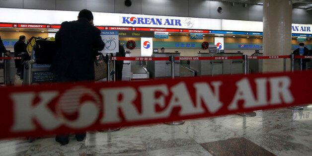 A Korean Air logo is seen at its domestic ticketing counter at Gimpo Airport in Seoul, South Korea, Tuesday,...