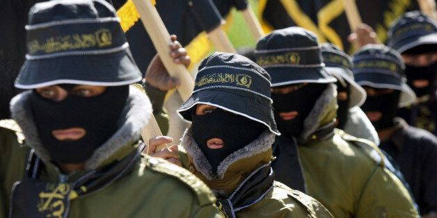 Palestinian masked supporters of the Islamic Jihad movement participate Sunday Nov. 12, 2006 in a march...