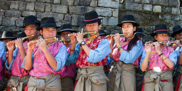 Exile Tibetan students of the Tibetan Children's Village School perform a traditional tune during the...