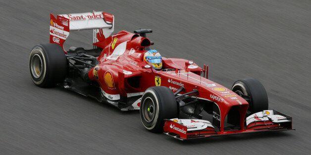 Ferrari driver Fernando Alonso of Spain steers his car during the Korean Formula One Grand Prix at the...
