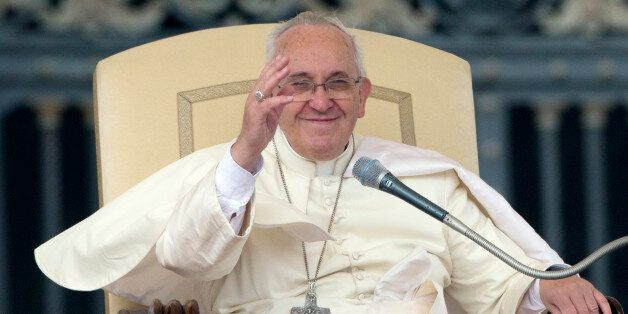 Pope Francis waves to the faithful during his weekly general audience, in St.Peter's Square, at the Vatican,...