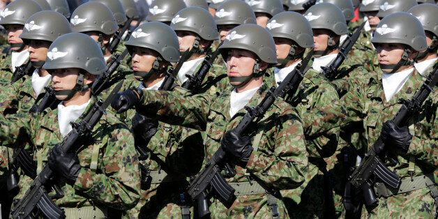 FILE - In this Oct. 27, 2013 file photo, members of Japan Self-Defense Forces march during the Self-Defense...