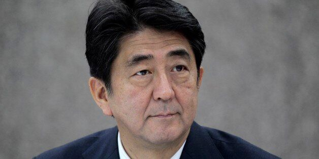 Japanese Prime Minister Shinzo Abe attends a signing of agreements meeting with his Bangladeshi counterpart...