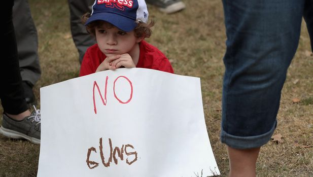 ROUND ROCK, TX - MARCH 24:  Ryan Price, 6, participates in a March for Our Lives rally on March 24, 2018 in Round Rock, Texas. More than 800 March for Our Lives events, organized by survivors of the Parkland, Florida school shooting on February 14 that left 17 dead, are taking place around the world to call for legislative action to address school safety and gun violence.  (Photo by Scott Olson/Getty Images)