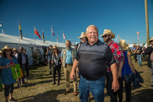 Ontario Premier Doug Ford welcomes visitors to the International Plowing Match in Verner, Ont. during...