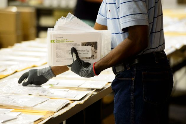 Workers prepare shipments at the Elections Canada distribution centre as in Ottawa on Aug. 29,