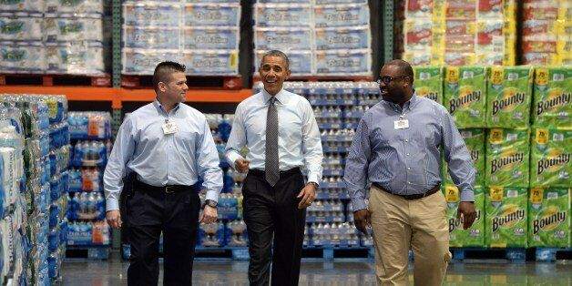 US President Barack Obama tours the Costco in Lanham, Maryland, on January 29, 2014 before speaking to...