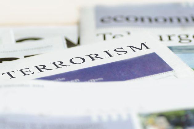 Daily news newspaper headline reading terrorism