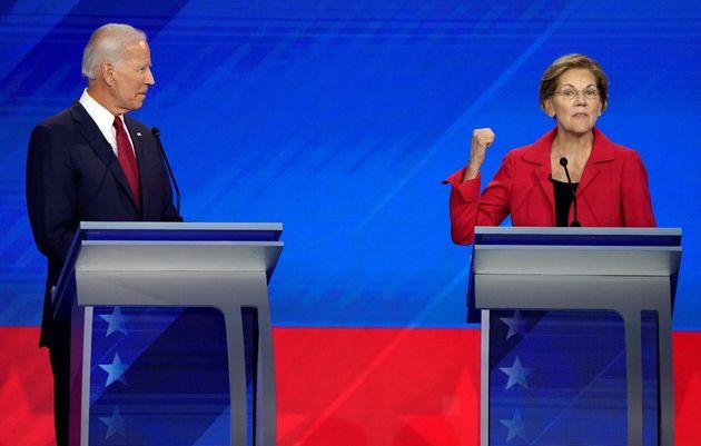 Former Vice President Joe Biden listens to Senator Elizabeth Warren during the 2020 Democratic U.S. presidential...