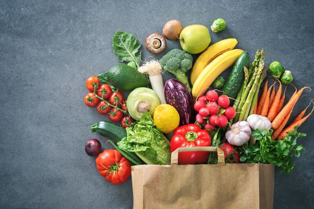 Healthy food selection. Shopping bag full of fresh vegetables and fruits. Flat lay food on