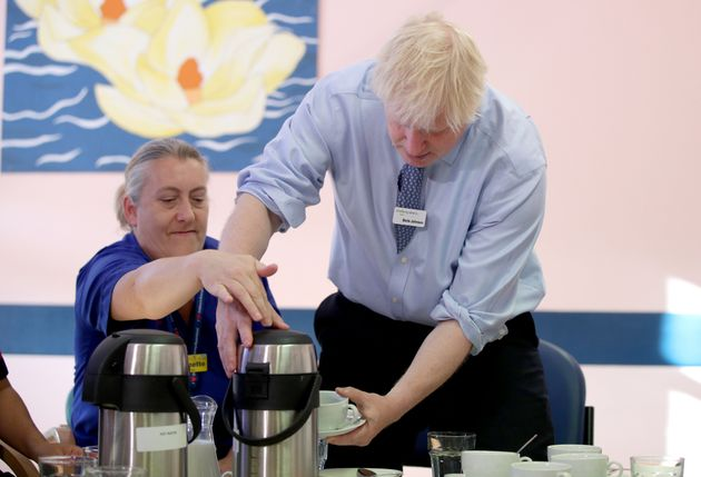 Prime Minister Boris Johnson meets members of staff during a visit to Whipps Cross University Hospital...