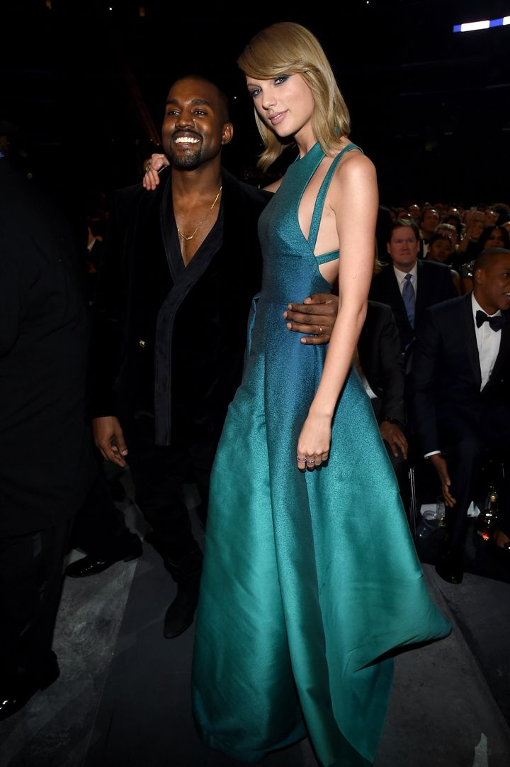 Kanye West and Taylor Swift pose for a photo together at the 2015 Grammys.