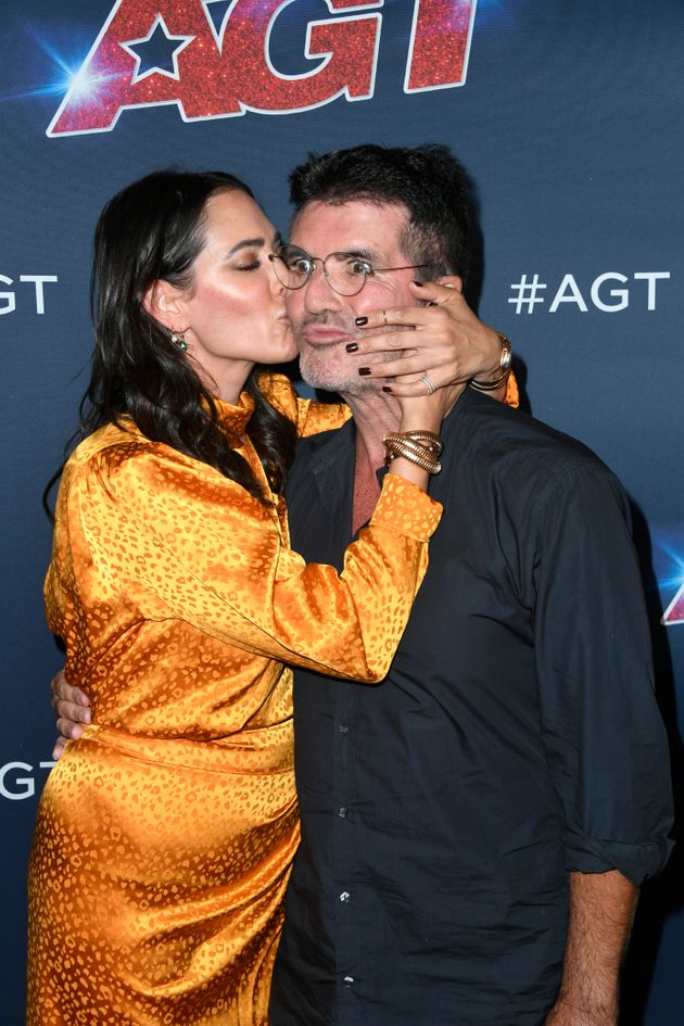 Simon Cowell's Face Looks Like It Wants To Run Away From Girlfriend Lauren Silverman At The America's...
