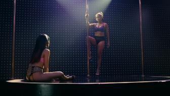"Constance Wu and Jennifer Lopez in ""Hustlers."""