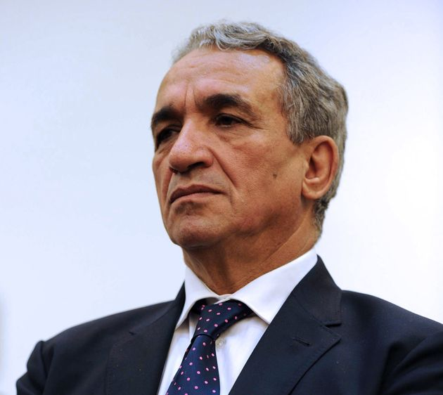 Algerian Minister of Post and Information Technology and Communication Moussa Benhamadi listens to a...