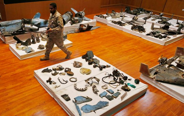 A Saudi military officer walks by what was described asa the remains of Iranian cruise missiles and drones...