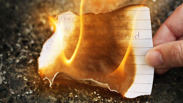 Woman burning love letter.