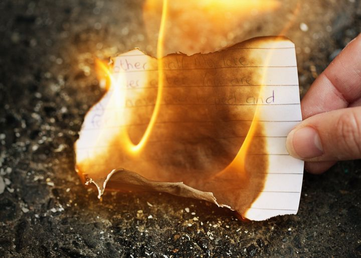 Woman burning love letter.
