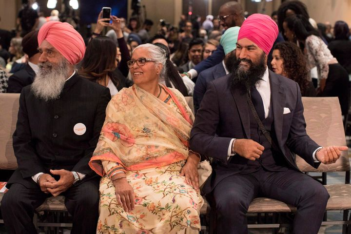 Jagmeet Singh (right) sits with his mother Harmeet Kaur (centre) and father Jagtaran Singh (left) attendees arrive hear the first ballot in the NDP leadership race in Toronto on Oct. 1, 2017.