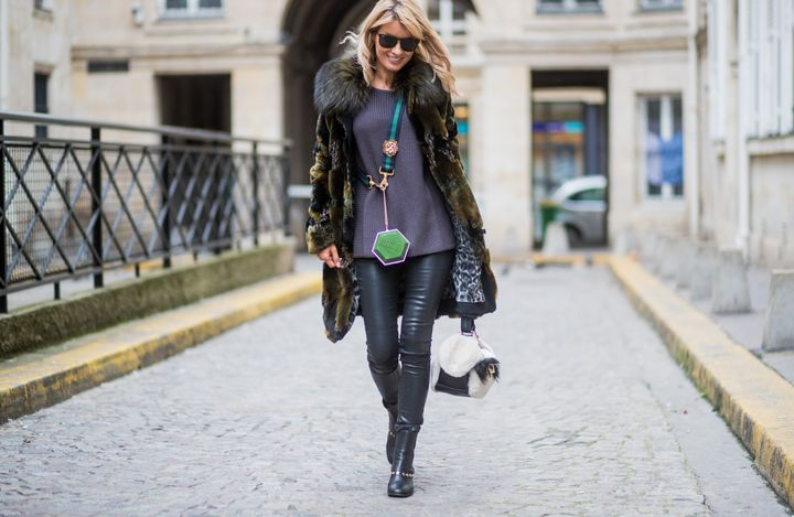 Model and fashion blogger Gitta Banko wears black-coated jeans in Paris.