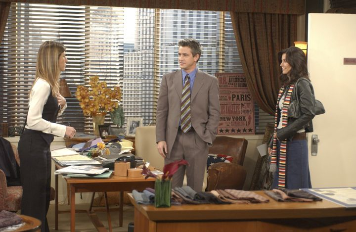 Rachel Green on her first day back to work from maternity leave alongside Gavin, and Monica Geller-Bing.