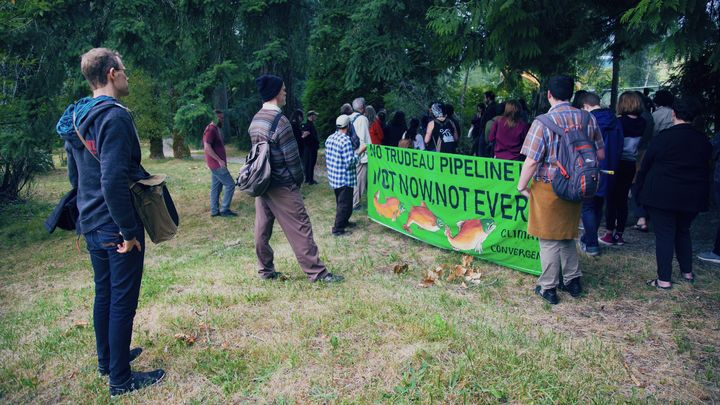 """Members of a """"resistance walk"""" against Trans Mountain pipeline expansion are shown in Burnaby, B.C. in July 2019."""
