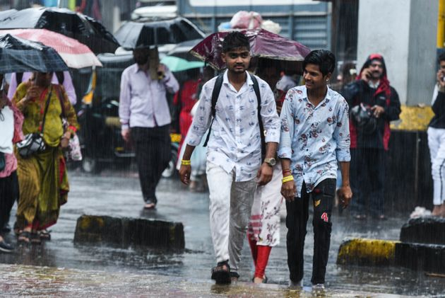 People deal with heavy rains in suburbs at Borivali on September 17, 2019 in