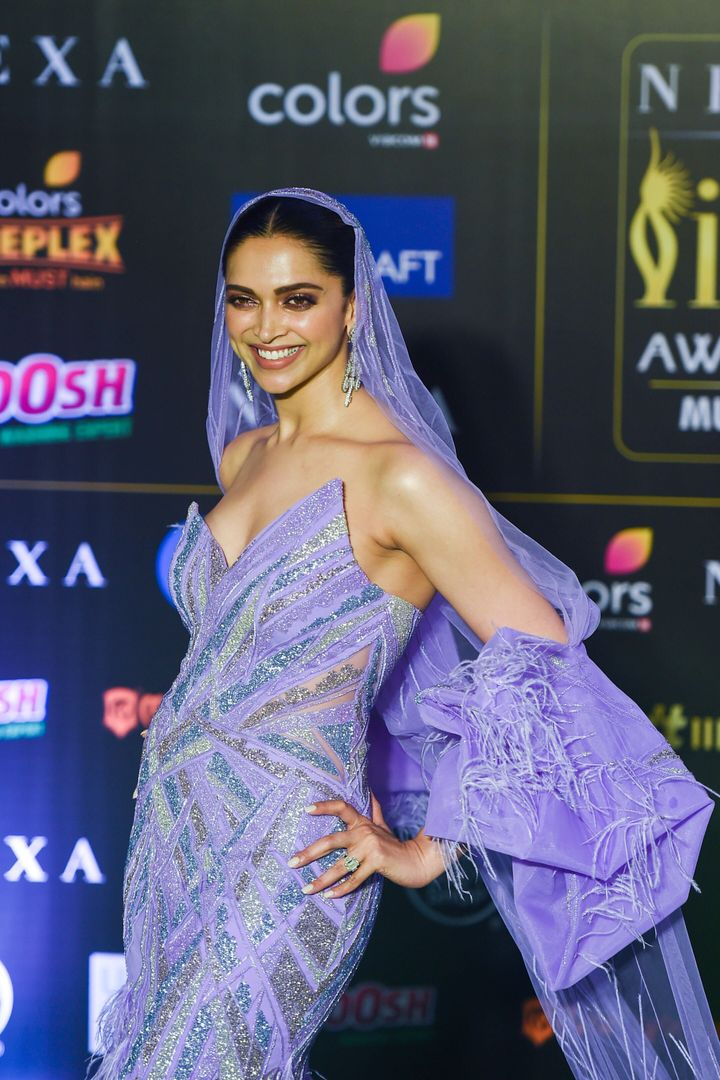 Deepika Padukone in custom purple gown and veil by Gaurav Gupta at the 20th International Indian Film Academy (IIFA) Awards in Mumbai. Padukaone won the Special 20 Award for <i>Chennai Express</i>.