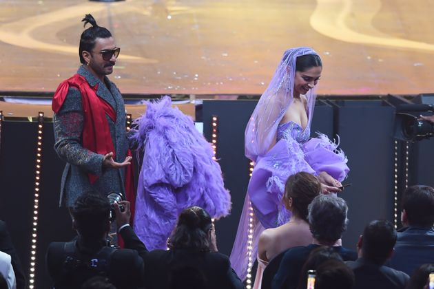 Ranveer Singh carries the back Deepika Padukone's dress during IIFA