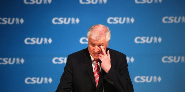 Bavarian Prime Minister and head of the Christian Social Union (CSU) Horst Seehofer gives a news conference...