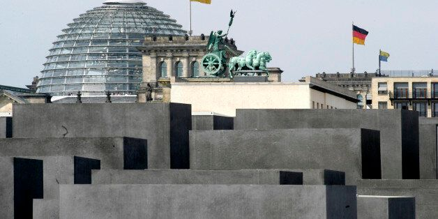 (GERMANY OUT) Germany Berlin Mitte - Holocaust cenotaph, in the background the Brandenburg Gate and the...