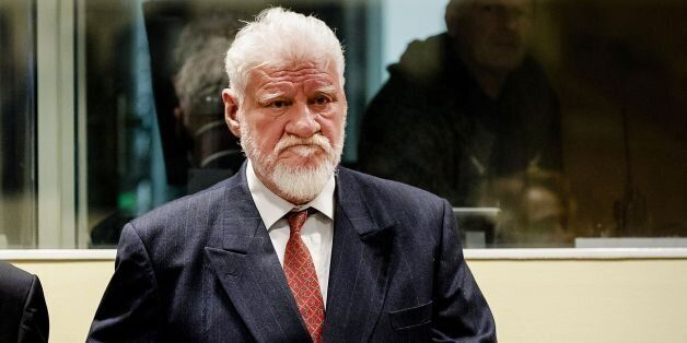 Croatian former general Slobodan Praljak stands prior to the start of his appeal judgement at the International...