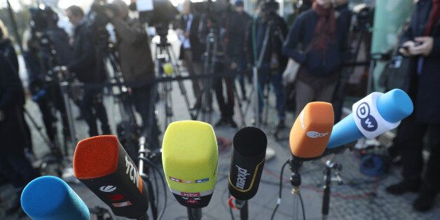 BERLIN, GERMANY - NOVEMBER 17: Television and radio crews' microphones stand ready as politicians arrive...