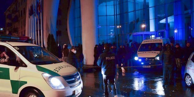 Georgian police investigators and ambulance cars are seen in front of the Leogrand hotel in Georgia's...