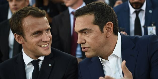 French President Emmanuel Macron (L) speaks with Greek Prime Minister Alexis Tsipras after arriving on...
