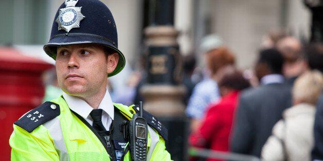 London, UK - April 29, 2011: London Metropolitan Police Officer in Central London keeping the streets...