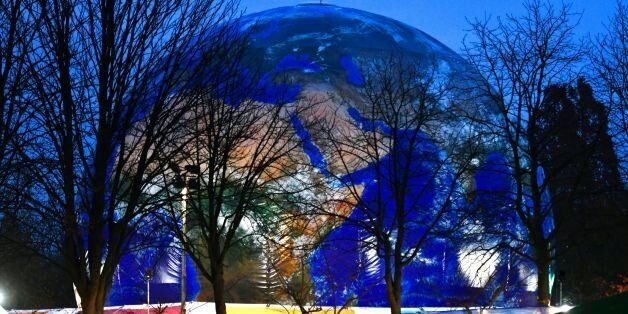 A mockup of a planet earth is displayed at the Rheinaue park during the COP23 United Nations Climate...