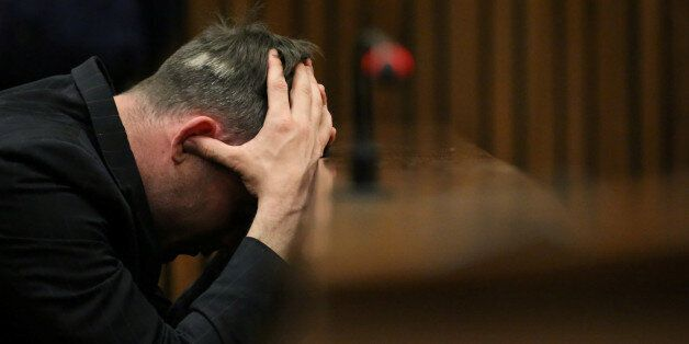 FILE PHOTO Paralympic gold medalist Oscar Pistorius reacts during the third day of the re-sentencing...