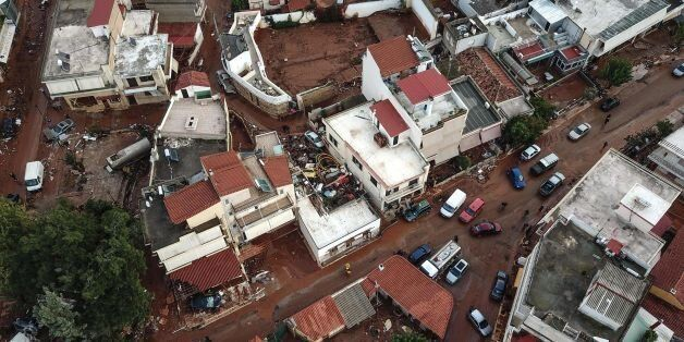 A drone picture taken on November 16, 2017 shows damage and mud covered streets in the town of Mandra,...