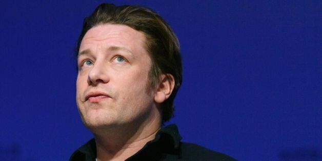 British chef Jamie Oliver attends a session on the second day of the World Economic Forum, on January 18, 2017 in Davos.With the world's elite holding its breath until Donald Trump becomes the next US president, outgoing Vice-President Joe Biden addresses the World Economic Forum in Davos / AFP / FABRICE COFFRINI        (Photo credit should read FABRICE COFFRINI/AFP/Getty Images)