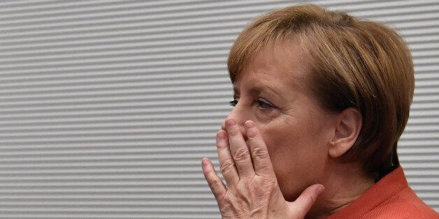 German Chancellor Angela Merkel arrives prior to a parliamentary group meeting of the conservative CDU/CSU...