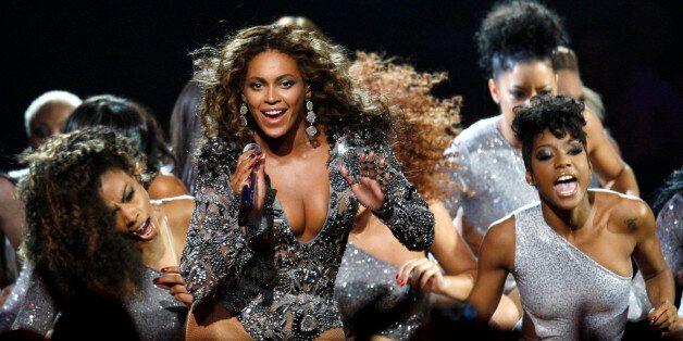 Beyonce (C) performs