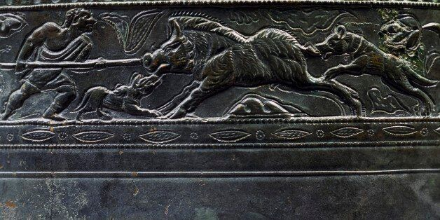 Frieze depicting a boar hunt, detail from a bronze situla. Roman Civilisation, 2nd-3rd