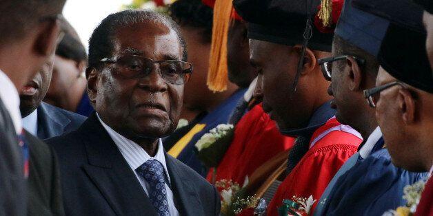 Zimbabwe President Robert Mugabe attends a university graduation ceremony in Harare, Zimbabwe, November...