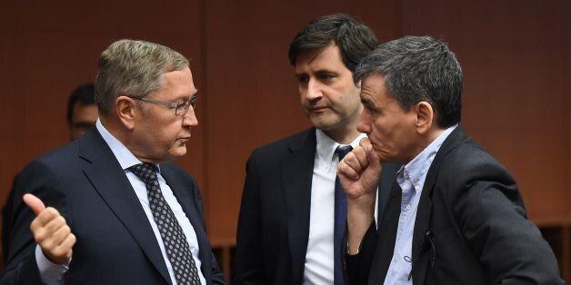 (L-R) Managing Director of the European Stability Mechanism Klaus Regling, Greek Alternate Minister of...