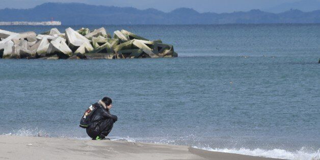 A man visits the seashore in Sendai's Arahama area, Miyagi prefecture on March 11, 2017 to pray for victims...